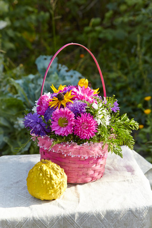 chrysanthemum bouquet in a basket Stock Photo