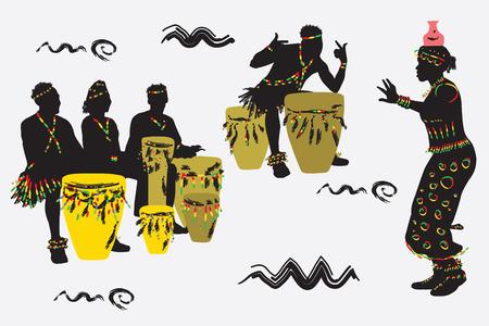 Músicos africanos bailan y juegan los tambores.