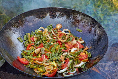 Chinese vegetables cooked in a wok.