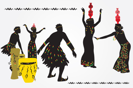 folk dance: African folk dance. Young men and women dancing and playing the drums.