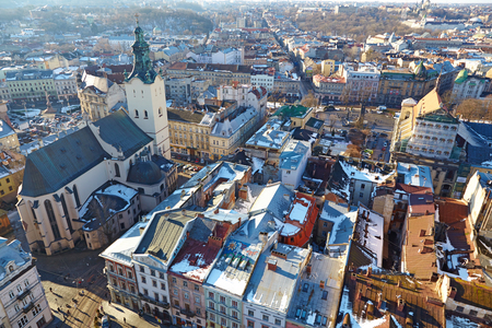 LVIV, UKRAINA -- CIRCA DECEMBER 2013: Winter view of the city center and Latin Cathedral from the Town Hall