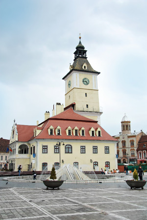 BRASOV, ROMANIA - CIRCA APRIL 2009: Town Hall  on the central square. In the background the Orthodox church. Editorial