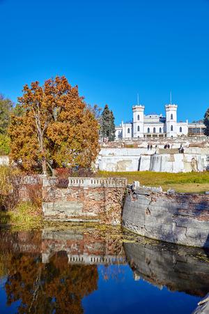 SHAROVKA, UKRAINE - CIRCA OCTOBER 2015: The White Swan palace onautumn nature background. Editorial