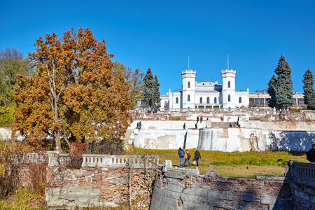 SHAROVKA, UKRAINE - CIRCA OCTOBER 2015: The White Swan palace on blue sky background. Tourists come to inspect the castle.
