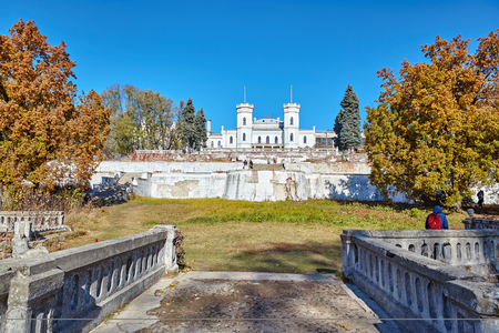 SHAROVKA, UKRAINE - CIRCA OCTOBER 2015: The White Swan palace on blue sky background. View from the Bridge.