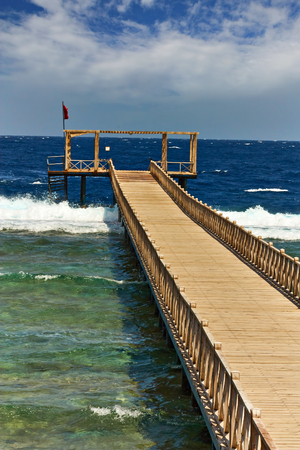 A new wooden pier for swimming and walking. Typical view of the hotel in Egypt. Reklamní fotografie