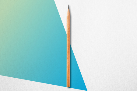 Minimalist template with copy space by top view close up photo of wooden pencil put in the center of texture white paper and combine with blue green gradient quirk Banque d'images