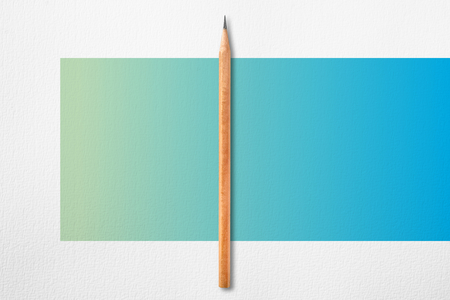 Minimalist template with copy space by top view close up photo of wooden pencil put in the center of texture white paper and combine with blue green rectangle.Flash light made pencil have smooth shadow.