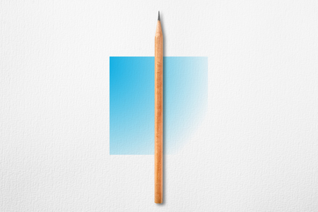 Minimalist template with copy space by top view close up photo of wooden pencil put in the center of texture white paper and combine with blue gradient square. Flash light made pencil have smooth shadow.
