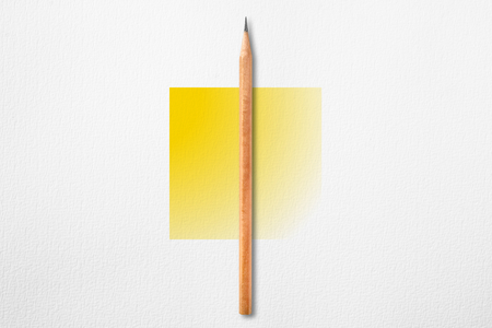 Minimalist template with copy space by top view close up photo of wooden pencil put in the center of texture white paper and combine with yellow gradient square. Flash light made pencil have smooth shadow.