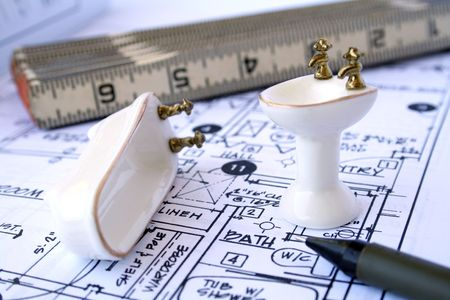 designing: Drafting bathroom - blueprint, ruler, mechanical pencil and miniature bathtub and sink Stock Photo