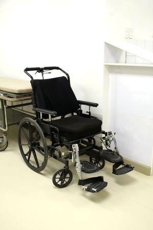 aide: Black Wheelchair Stock Photo