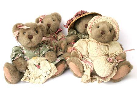 vintage teddy bears: Quattro annata Teddy porta su bianco  Archivio Fotografico