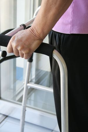 hinder: Person with disability using a walker Stock Photo