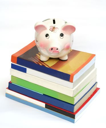college fund savings: Saving for Education (Piggy Bank over Stack of Books) Stock Photo