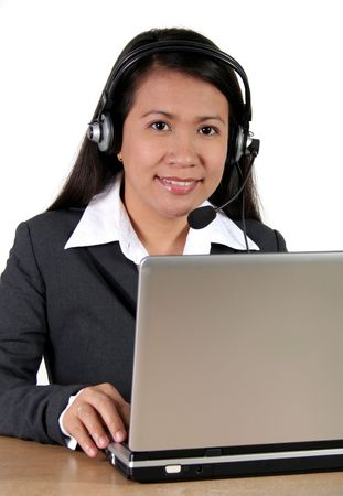Asian Call Center Agent working with Laptop photo