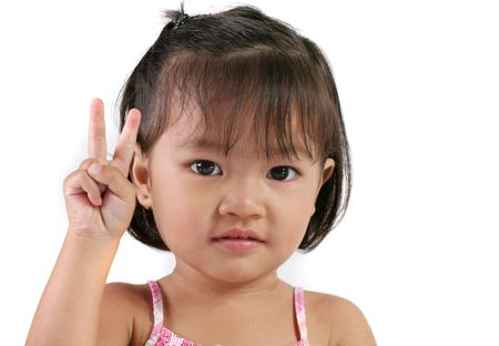 Asian Child signing Two against white background photo