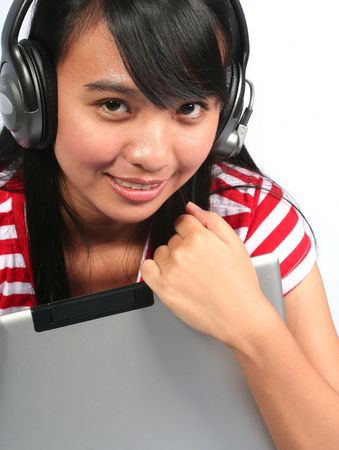 Asian Teen with Headset and a Laptop photo