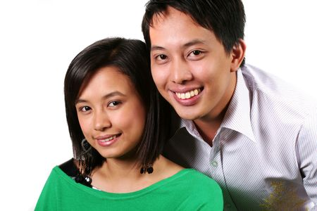 Young Asian Couple Smiling against White Background Stock Photo - 2833590