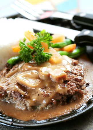 sizzling: Sizzling Burger Steak with Rice and Vegetables Stock Photo