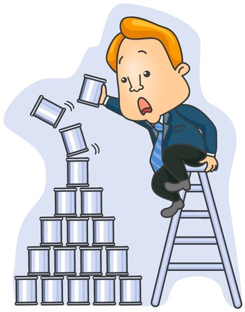 stacking: Businessman building Unsteady pyramid cans