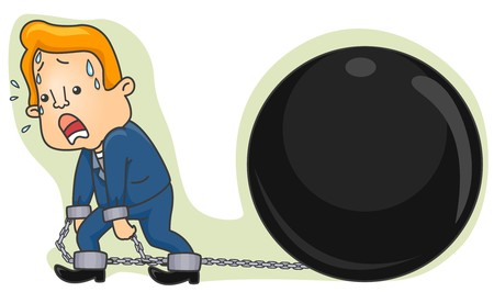 chained: A Sweating Businessman Pulling A Giant Metal Ball Chained to His Ankles Stock Photo