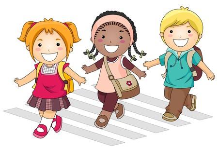 schooler: Un piccolo gruppo di bambini di attraversamento della via di andare a scuola
