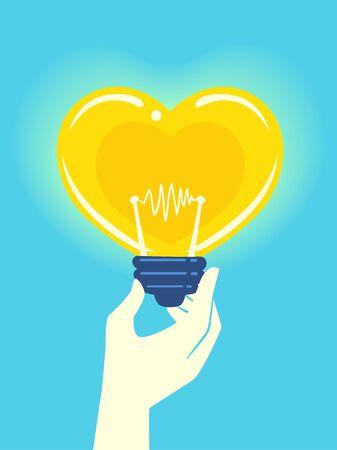 Hand Holding a Light Bulb Shaped Like a Heart. Donation Idea