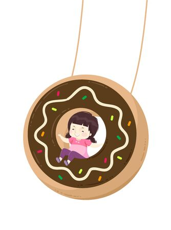 Happy and Smiling Kid Girl Riding a Chocolate Donut Swing Фото со стока