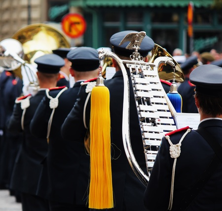 yellow tassel: military band from behind with yellow tassel on chimes