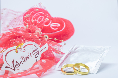 Valentiness day, Condom Prevent Pregnancy Contraception Valentines safe sex young love concept, Birth Control with Condom love and ring on white background. 写真素材