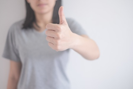 beautiful Asian woman showing thumbs up isolated on a white background with copy space 免版税图像