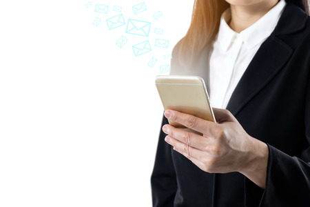 business young woman wearing black suit standing using mobile smart phone sending message or sending email, business communication technology concept isolated on white background copy space