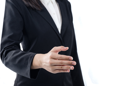 business young woman with open hand ready to seal a deal, handshake with business people,business etiquette, congratulation,merger and acquisition concepts isolated on white background with copy space 免版税图像