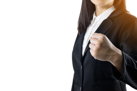 business woman wearing black suit standing show handful of achievements isolated on white background.She is confident of success isolated on white background with copy space 免版税图像