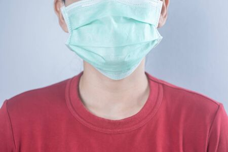 Closeup woman wear hygiene protective mask for protect COVID-19 virus. coronavirus crisis. Face of a woman wearing a mask that protects against the spread of virus disease.Hygiene concept. 免版税图像