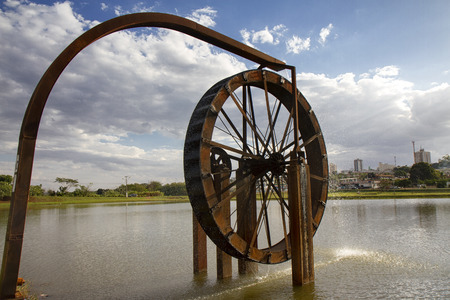 water mill: Wooden water mill isolated on lake Stock Photo