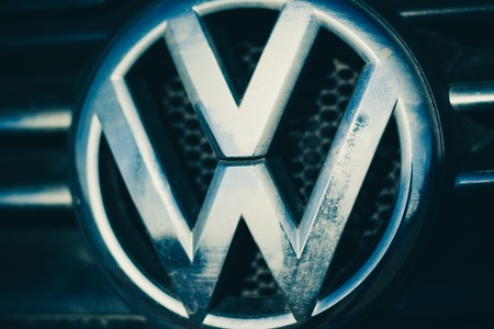headquartered: Russia - April 22, Volkswagen logo on April 22,2016 in Russia.  Volkswagen is a German automobile manufacturer headquartered in Wolfsburg, Lower Saxony, Germany.
