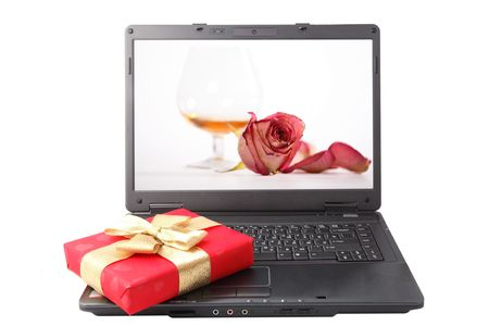 red gift box lies on the laptop keyboard Stock Photo - 4614512