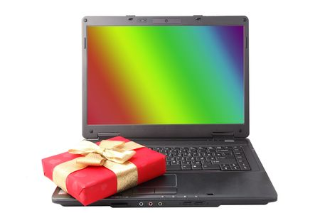 red gift box lies on the laptop keyboard Stock Photo - 4614507