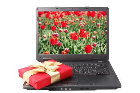 red gift box lies on the laptop keyboard Stock Photo - 4614513