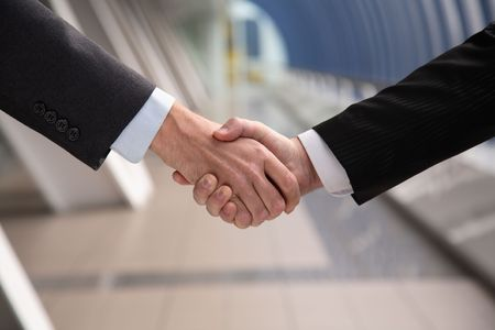 spent: Business hand shake. Successfully spent transaction.