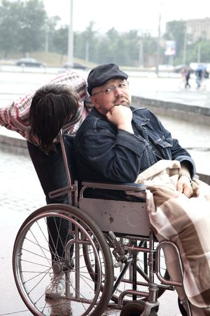 man in an invalid carriage and his wife on walk Stock Photo - 5107260