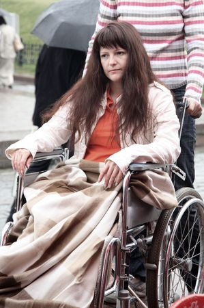 young woman on walk in an invalid carriage Stock Photo - 5107259