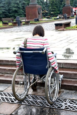wheelchair access: woman -  invalid tries to overcome ladder steps