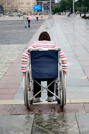 invalidity: woman -  invalid tries to overcome ladder steps