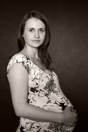 Portrait of the young beautiful pregnant woman photo