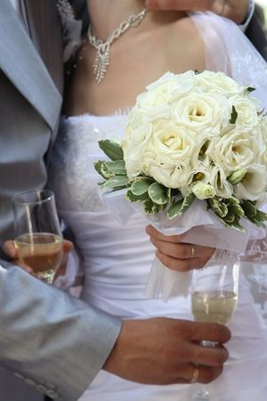 Wedding bouquet from roses in hands at the bride photo
