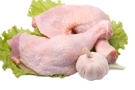 Crude chicken legs lie on salad leaves Stock Photo - 5658898