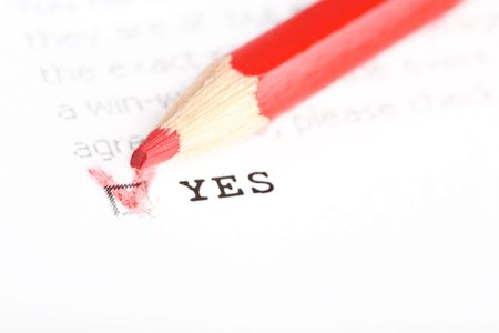 Questionnaire with choices. 'Yes' box ticked by red pencil. Stock Photo - 5819380